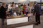 The Derby Horse race Epsom Downs Surrey Uk Circa 1985. Lady wearing colourful wig has had too much to drink, she is drunk.