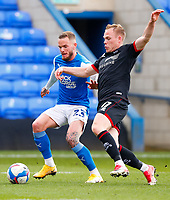 1st May 2021; Weston Homes Stadium, Peterborough, Cambridgeshire, England; English Football League One Football, Peterborough United versus Lincoln City; Anthony Scully of Lincoln City tackles Joe Ward of Peterborough United