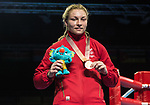 Wales Lauren Price with her gold medal after beating Caitlin Parker in the Woman's 75kg Final Bout<br /> <br /> *This image must be credited to Ian Cook Sportingwales and can only be used in conjunction with this event only*<br /> <br /> 21st Commonwealth Games - Boxing - Day 10 - 14\04\2018 - Oxenford Studios  - Gold Coast City - Australia