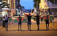 Teenagers with welsh flags in Oxford Street Swansea celebrate Wales' 3-0 win against Russia at the UEFA Euro 2016. Monday 20 June 2016