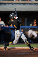 Bristol Pirates catcher Manny Bejerano (24) follows through on a swing during the first game of a doubleheader against the Bluefield Blue Jays on July 25, 2018 at Bowen Field in Bluefield, Virginia.  Bluefield defeated Bristol 6-3.  (Mike Janes/Four Seam Images)
