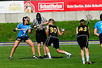 BERLIN, GERMANY - JUNE 21: Match of Team Germany (black) vs Team Switzerland (light blue) during the Berlin Open Lacrosse Tournament 2013 at Stadion Lichterfelde on June 21, 2013 in Berlin, Germany. Final score 20-0. (Photo by Dirk Markgraf/www.265-images.com) *** Local caption *** <br /> #30 Anna Blank of Germany, #43 Pia Balz of Germany