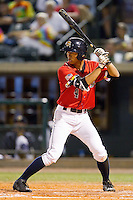 Gosuke Katoh (4) of the Charleston RiverDogs at bat against the Greenville Drive at Joseph P. Riley, Jr. Park on May 26, 2014 in Charleston, South Carolina.  The Drive defeated the RiverDogs 11-3.  (Brian Westerholt/Four Seam Images)