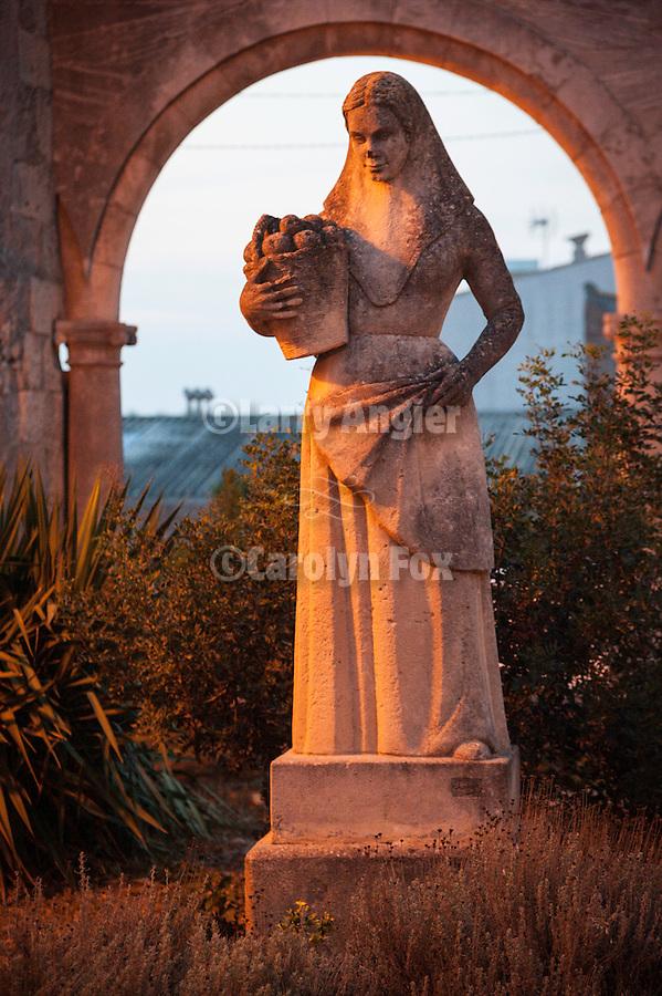 Statue of a woman with basket, Església de Sant Pere, Petra, Mallorca