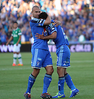 BOGOTA -COLOMBIA. 05-04-2014. Fabian Vargas (Der de Millonarios   celebra su gol con Andres Cadavid (Izq) contra el Deportivo Cali  por la quinceava  fecha de La liga Postobon 1 disputado en el estadio Nemesio Camacho El Campin. /   Fabian Vargas (R)  and Andres Cadavid of Millonarios  celebrates his goal  against Deportivo Cali  during the match for the fifteenth  round of The Postobon one league match at Nemesio Camacho El Campin  Stadium . Photo: VizzorImage/ Felipe Caicedo / Staff
