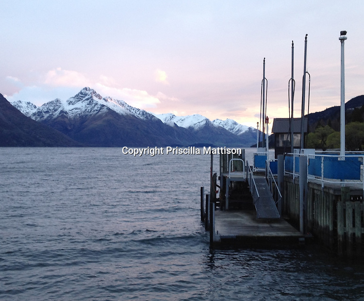 Queenstown, New Zealand - September 13, 2012:  Lavender twilight falls on Queenstown Bay and the Remarkables.