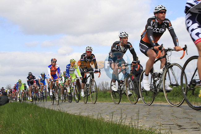 The peloton on the 2nd cobbled sector at Doorne during the 96th edition of The Tour of Flanders 2012, running 256.9km from Bruges to Oudenaarde, Belgium. 1st April 2012. <br /> (Photo by Steven Franzoni/NEWSFILE).