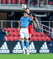 WASHINGTON, DC - APRIL 17: Frederic Brillant #13 of D.C. United goes up for a header with Valentin Castellanos #11 of New York City FC during a game between New York City FC and D.C. United at Audi Field on April 17, 2021 in Washington, DC.