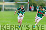 St Brendans Earnan Ferris gets past Jack Teahan of Mid Kerry in the Minor Football Championship quarter final.