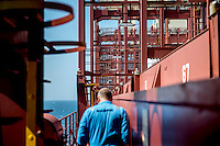 Captain Franz Holmberg walks one of the gangways on the Mary Maersk, the largest container ship in the world.