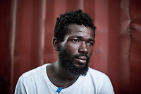 Asamoa Shia (Ghana, 25 yo) weeps aboard the Aquarius ship after was rescued with his wife and another 120 migrants off the shore of Libya. While working in Libya, he was arrested at home during a night raid carried out by an armed militia in Tripoli. Accordingly with his testimony he spent over two months in a prison camp from where he managed to escape with other 15 migrants. He was smuggled to Italy in a dinghy boat from Sabratah, in the west coast of Libya.