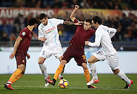 Calcio, Serie A: Roma vs ChievoVerona. Roma, stadio Olimpico, 22 settembre 2016.<br /> Roma's Stephan El Shaarawy, second from right, is challenged by Chievo Verona's Alessandro Gamberini, second from left, and Dario Dainelli, right, as his teammate Mohamed Salah looks on during the Italian Serie A football match between Roma and Chievo Verona, at Rome's Olympic stadium, 22 December 2016.<br /> UPDATE IMAGES PRESS/Isabella Bonotto
