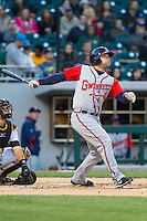 Steve Lerud (19) of the Gwinnett Braves connects for a solo home run against the Charlotte Knights at BB&T Ballpark on April 16, 2014 in Charlotte, North Carolina.  The Braves defeated the Knights 7-2.  (Brian Westerholt/Four Seam Images)
