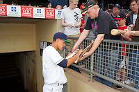 Cedar Rapids Kernels pitcher Jose Berrios #44 signs autographs prior to a game against the Lansing Lugnuts at Veterans Memorial Stadium on April 29, 2013 in Cedar Rapids, Iowa. (Brace Hemmelgarn/Four Seam Images)