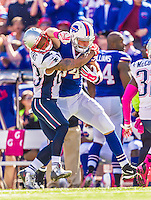 12 October 2014: Buffalo Bills tight end Scott Chandler is tackled by New England Patriots strong safety Patrick Chung at Ralph Wilson Stadium in Orchard Park, NY. The Patriots defeated the Bills 37-22 to move into first place in the AFC Eastern Division. Mandatory Credit: Ed Wolfstein Photo *** RAW (NEF) Image File Available ***