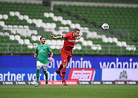 18th May 2020, WESERSTADION, Bremen, Germany; Bundesliga football, Werder Bremen versus Bayer Leverkusen;  Sven Bender (Leverkusen)  heads the ball clear as Leonardo Bittencourt (Bremen) watches play
