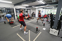 Angel Rangel and Roque Mesa exercise in the gym during the Swansea City Training at The Fairwood Training Ground, Swansea, Wales, UK. Thursday 21 September 2017