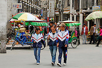 Tibetan schoolgirls crossing the street at a Barkhor alley, Lhasa, Tibet.