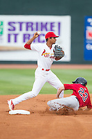 Johnson City Cardinals shortstop Oscar Mercado (4) attempts to turn a double play as Tanner English (23) of the Elizabethton Twins slides into second base at Cardinal Park on July 27, 2014 in Johnson City, Tennessee.  The game was suspended in the top of the 5th inning with the Twins leading the Cardinals 7-6.  (Brian Westerholt/Four Seam Images)