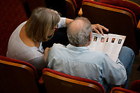 Audience members look through the program during Stage III at the 11th USA International Harp Competition at Indiana University in Bloomington, Indiana on Wednesday, July 10, 2019. (Photo by James Brosher)
