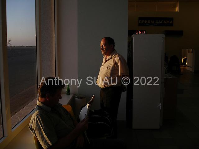 Yalta-Crimea, Ukraine.September 2, 2005 ..Businessmen waiting at the airport.