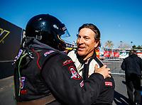 Feb 25, 2018; Chandler, AZ, USA; NHRA top fuel driver Greg Carrillo (right) greets Scott Palmer during the Arizona Nationals at Wild Horse Pass Motorsports Park. Mandatory Credit: Mark J. Rebilas-USA TODAY Sports