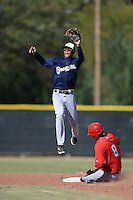 Milwaukee Brewers shortstop Angel Ortega (9) jumps for a high throw during an Instructional League game against the Los Angeles Angels on October 11, 2013 at Tempe Diablo Stadium Complex in Tempe, Arizona.  (Mike Janes/Four Seam Images)