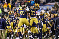 Philadelphia, PA - December 14, 2019:     Navy Midshipmen players celebrate during the 120th game between Army vs Navy at Lincoln Financial Field in Philadelphia, PA. (Photo by Elliott Brown/Media Images International)