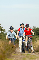 Jill , Sam and Gus riding bikes .Virginia Water, Surrey , April 2004.pic copyright Steve Behr / Stockfile