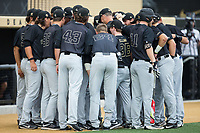 The Wake Forest Demon Deacons huddle up prior to the game against the West Virginia Mountaineers in Game Six of the Winston-Salem Regional in the 2017 College World Series at David F. Couch Ballpark on June 4, 2017 in Winston-Salem, North Carolina.  The Demon Deacons defeated the Mountaineers 12-8.  (Brian Westerholt/Four Seam Images)