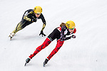 (R) Jessica Hewitt of Canada being followed by (L) Sayuri Shimizu of Japan during the Short Track Speed Skating as part of the 2014 Sochi Olympic Winter Games at Iceberg Skating Palace on February 10, 2014 in Sochi, Russia. Photo by Victor Fraile / Power Sport Images