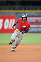 Columbus Clippers second baseman Erik Gonzalez (9) running the bases during a game against the Louisville Bats on May 1, 2017 at Louisville Slugger Field in Louisville, Kentucky.  Columbus defeated Louisville 6-1  (Mike Janes/Four Seam Images)