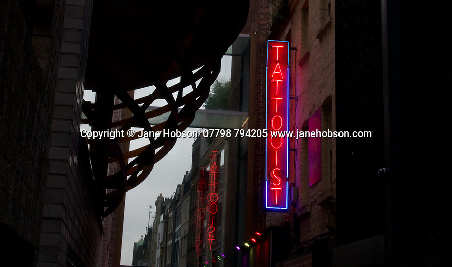 London, UK. 02.02.2020. Tattooist neon sign, Soho, London, UK. Photograph © Jane Hobson.