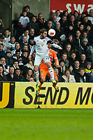 Thursday 28 November  2013  Pictured: Angel Rangel and Jonas in a mid air challenge<br /> Re:UEFA Europa League, Swansea City FC vs Valencia CF  at the Liberty Staduim Swansea