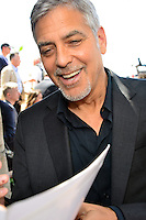 Actors George Clooney and Julia Roberts attend the 'Money Monster' photocall during the 69th annual Cannes Film Festival at the Palais des Festivals on May 12, 2016 in Cannes, France.
