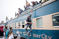 Muslim devotees jumped from an over-crowded train as they return home after a three-day World Congregation of Muslims, or Biswa Ijtema, on the banks of the River Turag just outside Dhaka, Bangladesh. Jan 11, 2015