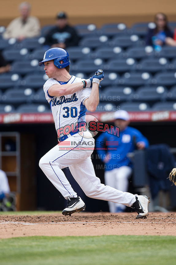 Jimmy Herron (30) of the Duke Blue Devils follows through on his swing against the California Golden Bears at Durham Bulls Athletic Park on February 20, 2016 in Durham, North Carolina.  The Blue Devils defeated the Golden Bears 6-5 in 10 innings.  (Brian Westerholt/Four Seam Images)