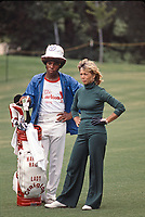 Marlene Hagge with caddy at the Carlton, a golf tournament on the LPGA Tour played at the Calabasas Country Club, Calabasas, California, September 1976. Photo by John G. Zimmerman.