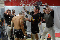 Rochester Red Wings infielders Eric Farris (no shirt), James Beresford and pitcher Logan Darnell celebrate in the locker room after defeating the Scranton Wilkes Barre RailRiders on September 2, 2013 at Frontier Field in Rochester, New York to clinch the International League Wild Card Playoff spot.  (Mike Janes/Four Seam Images)