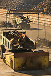 Scrap metal being loaded onto a ship for export