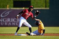 Altoona Curve shortstop Oneil Cruz (13) waits for a pickoff attempt throw as Daniel Cabrera (38) steals second base during a game against the Erie Seawolves on September 7, 2021 at Peoples Natural Gas Field in Altoona, Pennsylvania.  (Mike Janes/Four Seam Images)