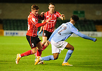 Lincoln City's Robbie Gotts vies for possession with Manchester City U21's Oscar Bobb<br /> <br /> Photographer Andrew Vaughan/CameraSport<br /> <br /> EFL Papa John's Trophy - Northern Section - Group E - Lincoln City v Manchester City U21 - Tuesday 17th November 2020 - LNER Stadium - Lincoln<br />  <br /> World Copyright © 2020 CameraSport. All rights reserved. 43 Linden Ave. Countesthorpe. Leicester. England. LE8 5PG - Tel: +44 (0) 116 277 4147 - admin@camerasport.com - www.camerasport.com