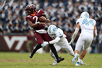BLACKSBURG, VA - OCTOBER 19: Herndon Hooker #2 of Virginia Tech is sacked by Myles Dorn #1 of the University of North Carolina during a game between North Carolina and Virginia Tech at Lane Stadium on October 19, 2019 in Blacksburg, Virginia.