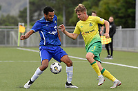 Harry Bark of Lower Hutt AFC competes for the ball with Alex Shepherd-Reynolds of Petone FC during the Central League Football - Petone FC v Lower Hutt AFC at Petone Memorial Park, Lower Hutt, New Zealand on Friday 2 April 2021.<br /> Copyright photo: Masanori Udagawa /  www.photosport.nz