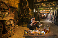 France, Calvados (14), Pays d' Auge,  Le Breuil-en-Auge, Château du Breuil,  les  chais à Calvados  du château,  le Maître de Chai , Philippe Etignard prépare un assemblage // France, Calvados, Pays d' Auge,  Le Breuil en Auge, Château du Breuil, Caivados cellar of  the castle, , Philippe Etignard cellar master make  a blending<br /> <br /> Auto N°: 2014-117