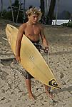 A surfer on the beach at on Kailua Beach in Hawaii.