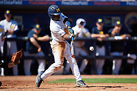 Michigan Wolverines second baseman Ako Thomas (4) at bat during a game against Army West Point on February 18, 2018 at Tradition Field in St. Lucie, Florida.  Michigan defeated Army 7-3.  (Mike Janes/Four Seam Images)