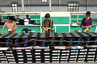 Workshop of a private export shoes factory in Ningbo, Zhejiang province, China. .