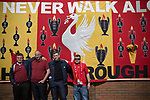 Four men pose for a photograph in front of a banner commemorating the 1989 Hillsborough stadium disaster, before the 25th anniversary memorial service to the disaster at Liverpool Football Club's Anfield Stadium. The Hillsborough disaster led to 96 Liverpool football fans losing their lives in a crush at an FA Cup semi final tie against Nottingham Forest. The families of the victims campaigned against the original verdict of the incident and were rewarded with a new inquiry held in 2014 into events at the match at Hillsborough. Photo by Colin McPherson.