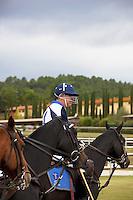 Italy. Tuscany. Polo Club Villa A Sesta is located near the village of Ripaltella and Pietraviva (Arezzo). Riccardo Tattoni is playing polo. He rides his horse before a polo game. Riccardo Tattoni is the owner of Polo Club Villa A Sesta. 17.09.10 © 2010 Didier Ruef